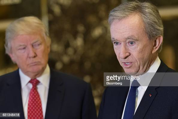 Bernard Arnault chairman and chief executive officer of LVMH Moet Hennessy Louis Vuitton SA speaks to members of the media as US Presidentelect...