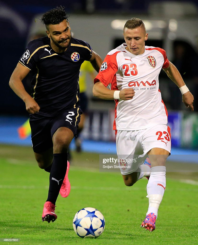Bernard Berisha (R) of KF Skenderbeu in action against El Arabi Hilal Soudani (L) of Dinamo Zagreb during the UEFA Champions League Qualifying Round Play Off Second Leg match between Dinamo Zagreb and FC Skenderbeu at Maksimir stadium in Zagreb, Croatia on Tuesday, August 25, 2015.