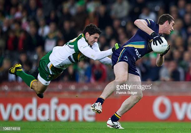 Bernard Brogan of Ireland attempts to tackle Tyson Goldsack of Australia in the second International Rules match between Ireland and Australia at...