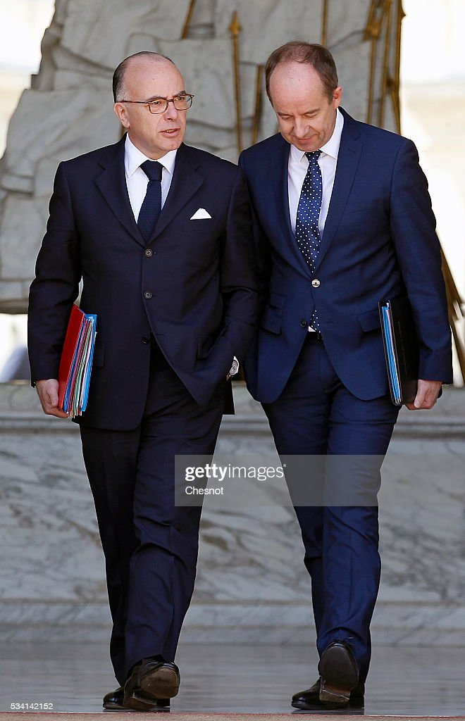 <a gi-track='captionPersonalityLinkClicked' href=/galleries/search?phrase=Bernard+Cazeneuve&family=editorial&specificpeople=4205153 ng-click='$event.stopPropagation()'>Bernard Cazeneuve</a>, French Minister of the Interior and Jean-Jacques Urvoas, Keeper of the Seals, Minister of Justice leave the Elysee Presidential Palace after a weekly cabinet meeting on May 25, 2016 in Paris, France. The French Government confirms that it tapped into its strategic reserves of petroleum products and said the equivalent of three days of inventory of 115 available had been used until now. the French government is facing a serious crisis following the El Khomri law.