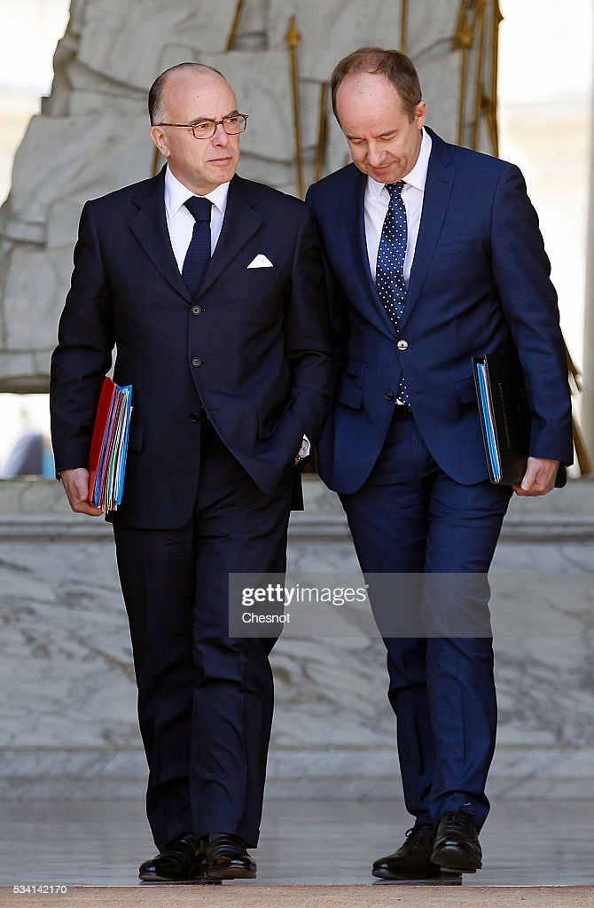 Bernard Cazeneuve, French Minister of the Interior and Jean-Jacques Urvoas, Keeper of the Seals, Minister of Justice leave the Elysee Presidential Palace after a weekly cabinet meeting on May 25, 2016 in Paris, France. The French Government confirms that it tapped into its strategic reserves of petroleum products and said the equivalent of three days of inventory of 115 available had been used until now. the French government is facing a serious crisis following the El Khomri law.