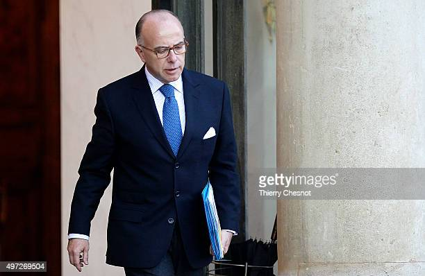 Bernard Cazeneuve French Minister of the Interior leaves after a meeting with the French President and the Prime Minister on November 15 2015 at the...