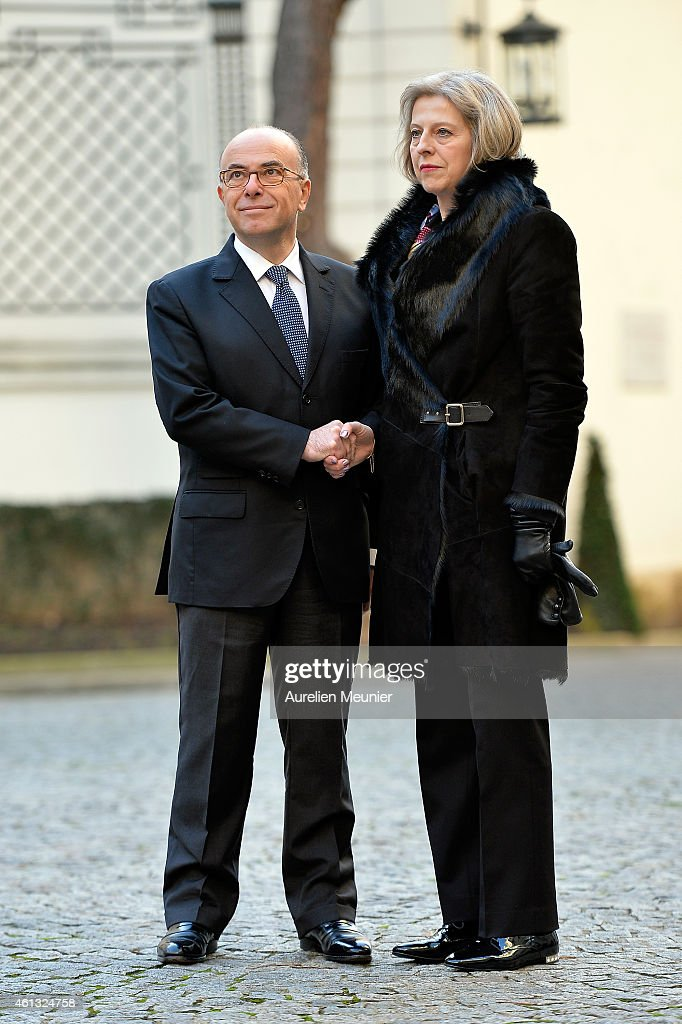 <a gi-track='captionPersonalityLinkClicked' href=/galleries/search?phrase=Bernard+Cazeneuve&family=editorial&specificpeople=4205153 ng-click='$event.stopPropagation()'>Bernard Cazeneuve</a> (L), FrenchMinister of Interior welcomes <a gi-track='captionPersonalityLinkClicked' href=/galleries/search?phrase=Theresa+May&family=editorial&specificpeople=832274 ng-click='$event.stopPropagation()'>Theresa May</a> (R) the Great Britain Minister of Interior during the meeting with ministers of interior and homeland security held in the ministry of interior Place Beauvau on January 11, 2015 in Paris, France. The meeting is organised prior a lunch at Palais de l' Elysee and they will all join the mass unity rally held in Paris following the recent terrorist attacks