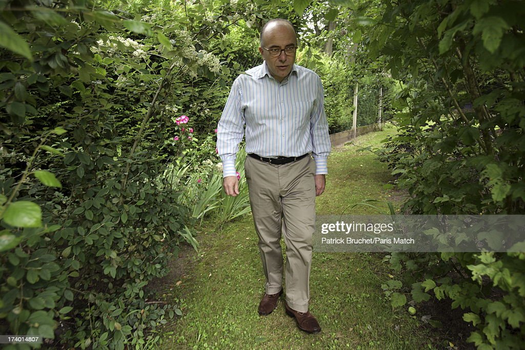Bernard Cazeneuve is photogrpahed for Paris Match on July 8, 2013 in Paris, France.