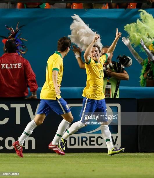 Bernard celebrates his first half goal with Oscar of Brazil against Honduras on November 16 2013 during a friendly match at SunLife Stadium Stadium...