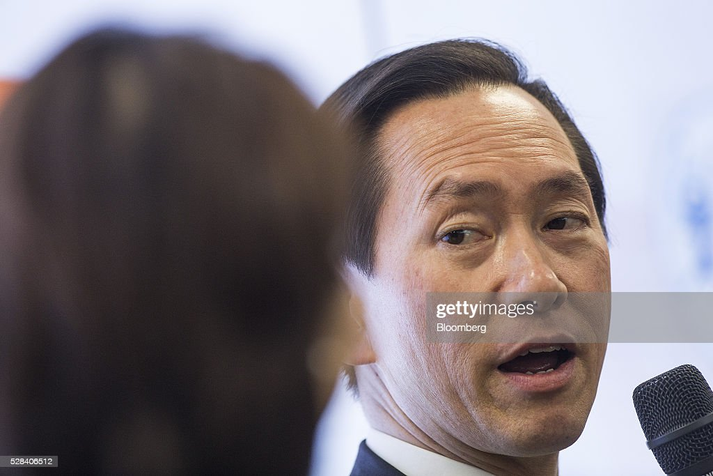 Bernard Charnwut Chan, president of Asia Financial Holdings Ltd., right, speaks during a news conference in Hong Kong, China, on Thursday, May 5, 2016. Alibaba Group Holding Ltd.'s HK$1 billion fund for Hong Kong entrepreneurs is investing in GoGoVan, a hauling and delivery service that's one of the city's biggest startups, and other online services. Photographer: Justin Chin/Bloomberg via Getty Images