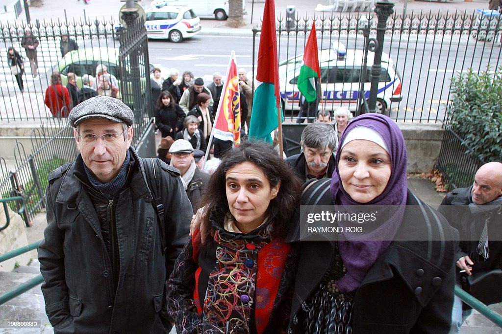 - Bernard Cholet, Jeanne Rousseau and Yamina Tadjeur followed by supporters arrive at the Perpignan courthouse on November 23, 2012 prior to their trial for distributing leaflets calling for the boycott of Israeli products coming from Westbank Jewish settlements. AFP PHOTO / RAYMOND