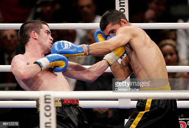 Bernard Dunn of Ireland hits Marian Leondraliu of Romania during the Super Bantamweight fight at the Arena of Leipzig on December 10 2005 in Leipzig...