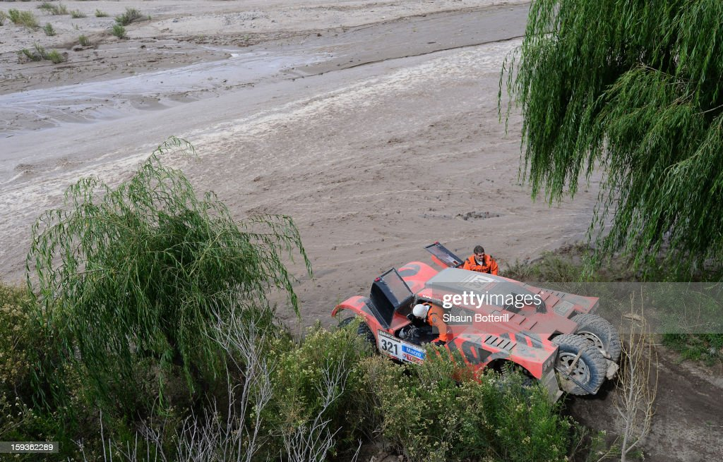 Bernard Errandonea and co-driver Arnaud Debron stop by a river after the stage from Salta to Tucuman was interupted by a flash flood during the 2013 Dakar Rally on January 12, 2012 in Salta, Argentina.