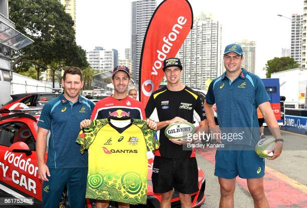 Bernard Foley Jamie Whincup Chaz Mostert and Rob Simmons pose for a photo during an Australian Wallabies media opportunity in Pit Lane ahead of the...