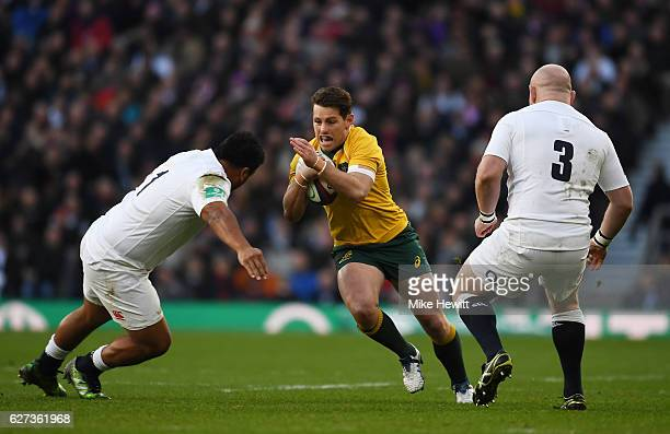 Bernard Foley of Australia attempts to take the ball past Dan Cole of England and Mako Vunipola of England during the Old Mutual Wealth Series match...