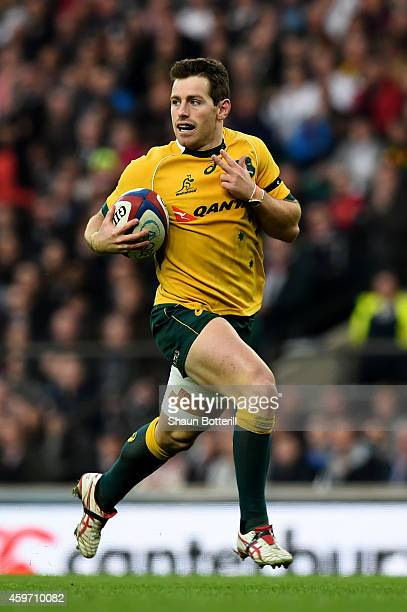 Bernard Foley of Australia breaks through to score his team's first try during the QBE international match between England and Australia at...