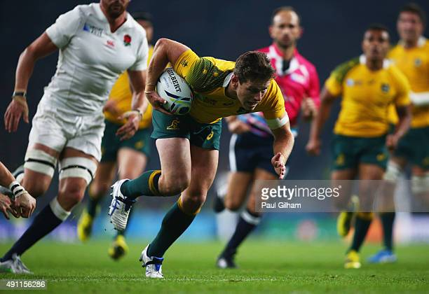 Bernard Foley of Australia breaks through to score their first try during the 2015 Rugby World Cup Pool A match between England and Australia at...