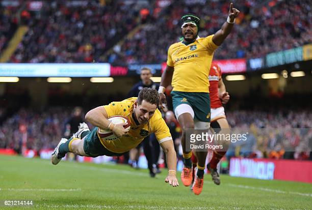 Bernard Foley of Australia dives over to score his team'sfourth try during the international match between Wales and Australia at the Principality...