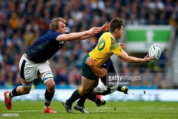 Bernard Foley of Australia offloads in the tackle during the 2015 Rugby World Cup Quarter Final match between Australia and Scotland at Twickenham...