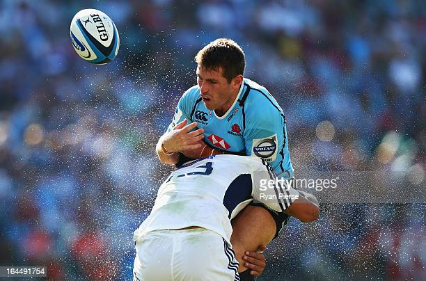 Bernard Foley of of the Waratahs is tackled by Rene Ranger of the Blues during the round six Super Rugby match between the Waratahs and the Blues at...