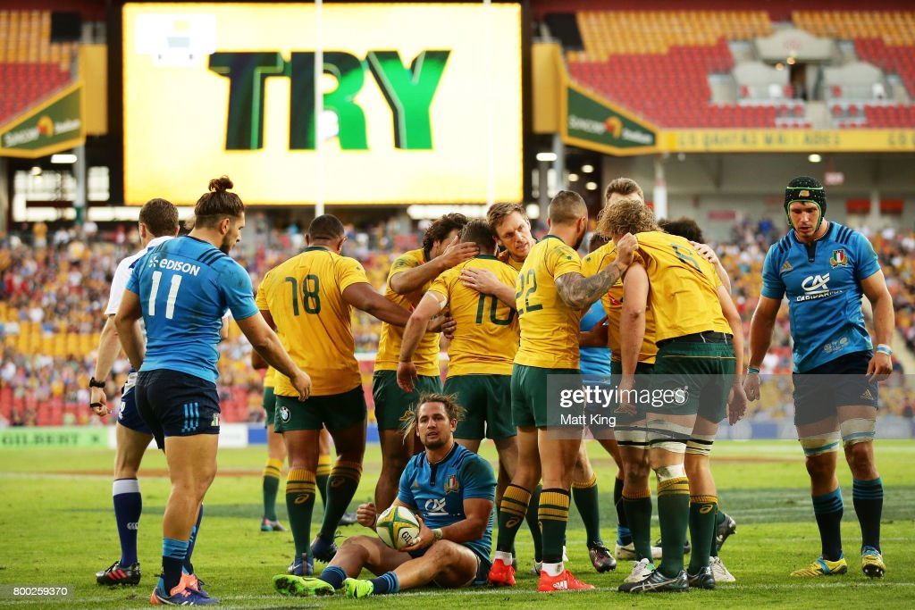 Bernard Foley of the Wallabies celebrates with team mates after scoring a try during the International Test match between the Australian Wallabies and Italy at Suncorp Stadium on June 24, 2017 in Brisbane, Australia.