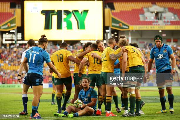 Bernard Foley of the Wallabies celebrates with team mates after scoring a try during the International Test match between the Australian Wallabies...