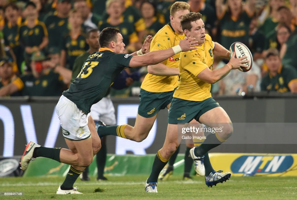 Bernard Foley of the Wallabies is pursued by Jesse Kriel of the Springboks during the Rugby Championship 2017 match between South Africa and Australia at Toyota Stadium on September 30, 2017 in Bloemfontein, South Africa.