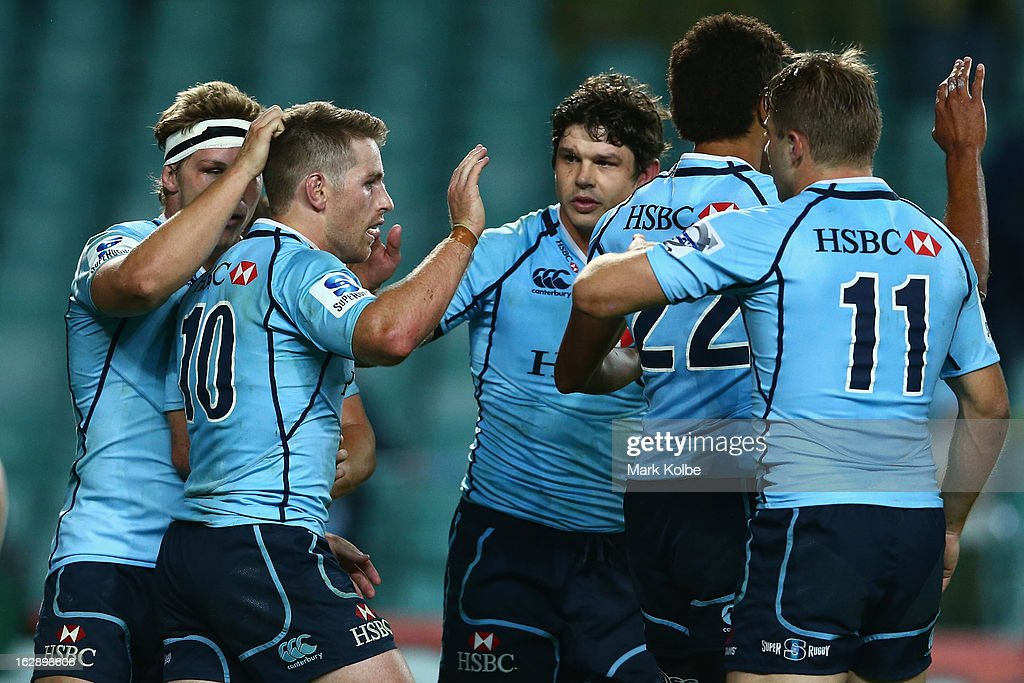 Bernard Foley of the Waratahs celebrates with his team mates after scoring a try during the round three Super Rugby match between the Waratahs and the Rebels at Allianz Stadium on March 1, 2013 in Sydney, Australia.