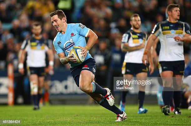 Bernard Foley of the Waratahs crosses for a try during the round 17 Super Rugby match between the Waratahs and the Brumbies at ANZ Stadium on June 28...