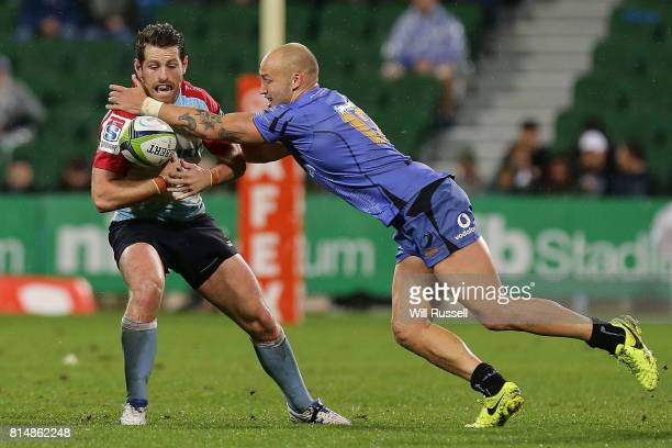 Bernard Foley of the Waratahs is tackled by Bill Meakes of the Force during the round 17 Super Rugby match between the Force and the Waratahs at nib...