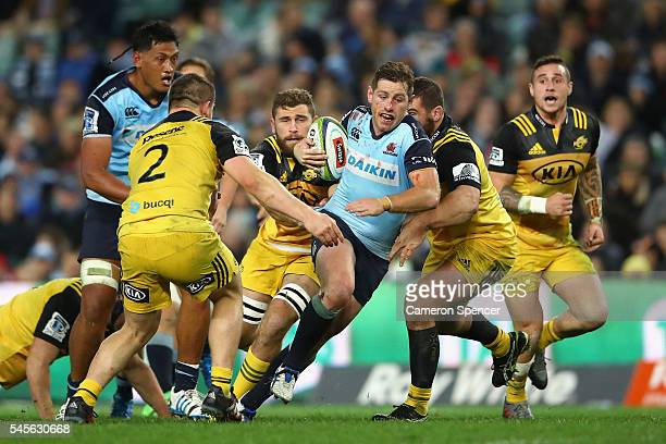 Bernard Foley of the Waratahs is tackled during the round 16 Super Rugby match between the Waratahs and the Hurricanes at Allianz Stadium on July 9...
