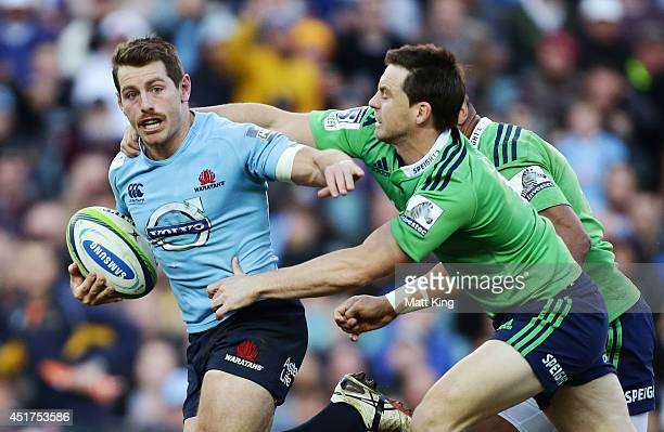 Bernard Foley of the Waratahs is tackled during the round 18 Super Rugby match between the Waratahs and the Highlanders at Allianz Stadium on July 6...