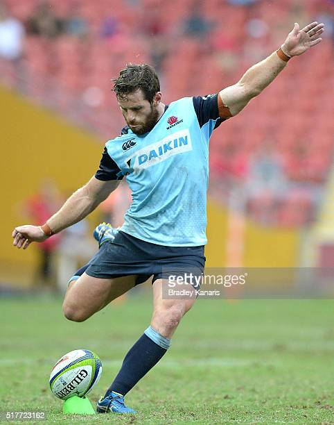 Bernard Foley of the Waratahs kicks for goal during the round five Super Rugby match between the Reds and the Waratahs at Suncorp Stadium on March 27...