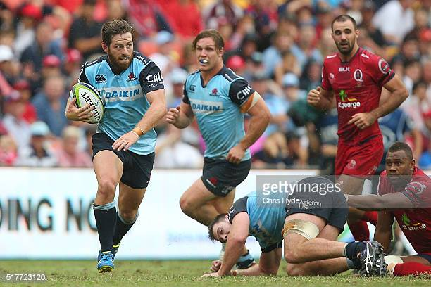 Bernard Foley of the Waratahs makes a break during the round five Super Rugby match between the Reds and the Waratahs at Suncorp Stadium on March 27...
