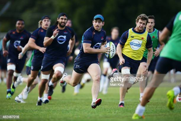 Bernard Foley of the Waratahs runs with the ball during a Waratahs Super Rugby training session at Moore Park on July 21 2014 in Sydney Australia