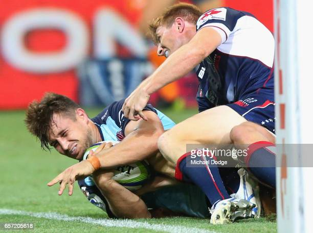 Bernard Foley of the Waratahs scores the winning try during the round five Super Rugby match between the Rebels and the Waratahs at AAMI Park on...