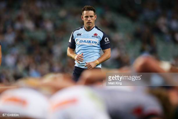 Bernard Foley of the Waratahs waits for the ball during the round nine Super Rugby match between the Waratahs and the Kings at Allianz Stadium on...