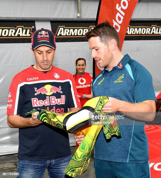 Bernard Foley presents Jamie Whincup with a Wallabies jersey during an Australian Wallabies media opportunity in Pit Lane ahead of the Gold Coast...