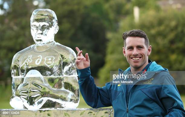 Bernard Foley stands next to an ice statue of himself during an Australian Wallabies media opportunity at Lough Playing Fields on June 15 2017 in...
