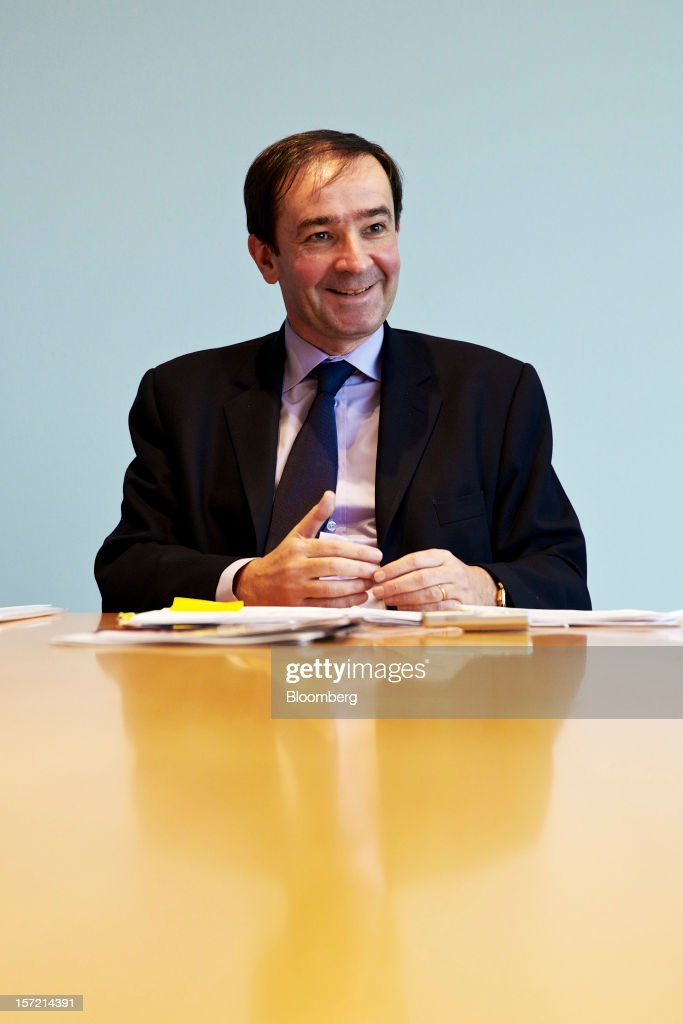 Bernard Fontana, chief executive officer of Holcim Ltd., reacts during an interview at the company's offices in Zurich, Switzerland, on Thursday, Nov. 29, 2012. Holcim Ltd., the world's largest cement maker, is considering disposals as Fontana deals with a greater-than-expected slowdown in Europe. Photographer: Gianluca Colla/Bloomberg via Getty Images