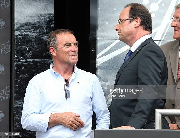 Bernard Hinault and French President Francois Hollande stand on the podium after Stage Nine of the Tour de France 2013 the 100th Tour de France a...