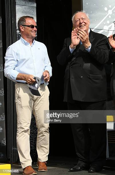 Bernard Hinault and JeanClaude Gaudin mayor of Marseille on the podium of Stage Five of the Tour de France 2013 the 100th Tour de France a 228km road...