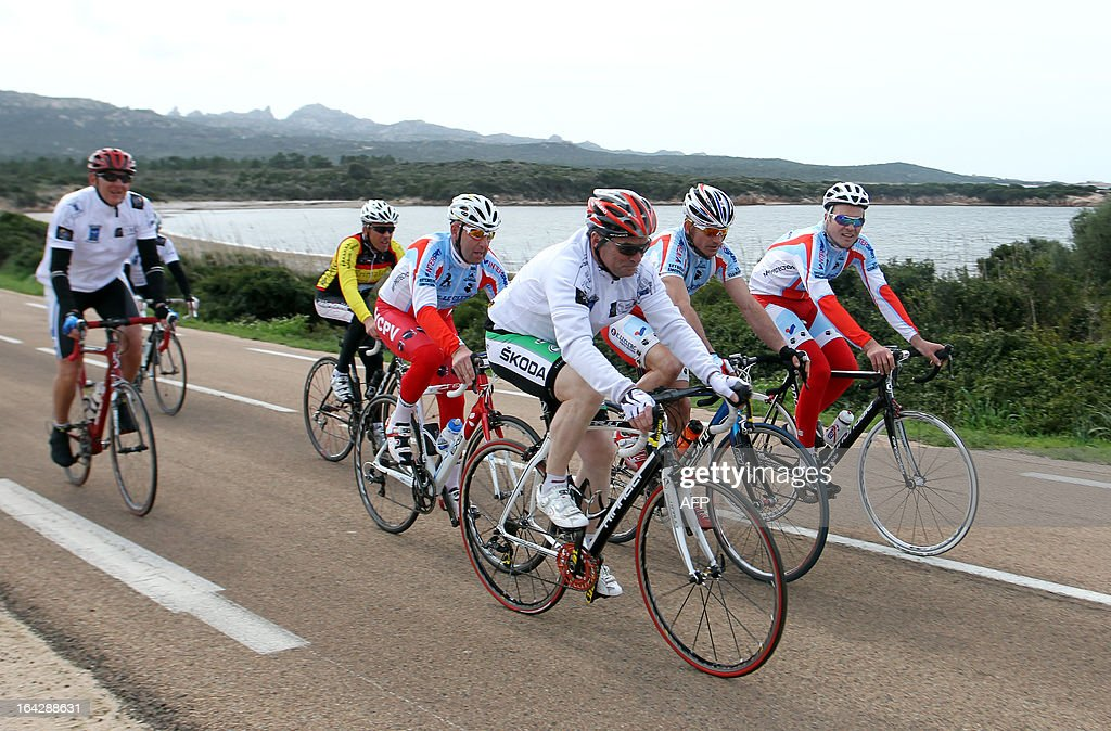 Bernard Hinault (3rd R), French former cyclist champion and member of the directory board of the Tour de France cycling race, cycles a 25 km ride on March 22, 2013 in Bonifacio, on the French Mediterranean island of Corsica, during an event to uncloak the countdown 100 days ahead of the race which will start from Porto-Vecchio, Corsica.