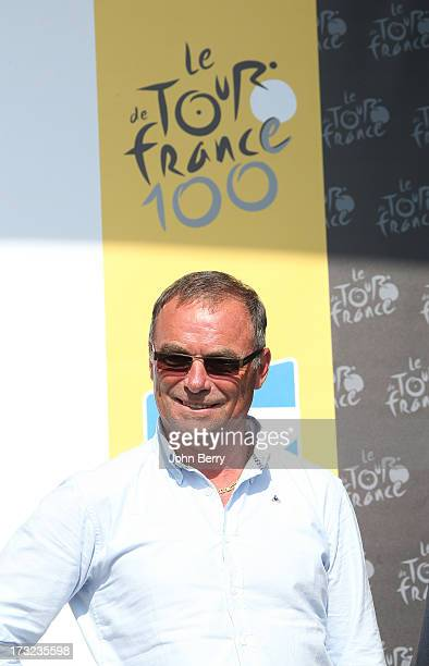 Bernard Hinault stands on the podium after Stage Eleven of the Tour de France 2013 the 100th Tour de France a 33 km individual time trial from...