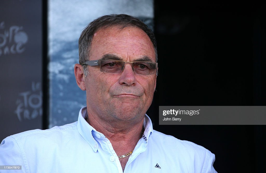 <a gi-track='captionPersonalityLinkClicked' href=/galleries/search?phrase=Bernard+Hinault&family=editorial&specificpeople=749939 ng-click='$event.stopPropagation()'>Bernard Hinault</a> stands on the podium after Stage Seven of the Tour de France 2013 - the 100th Tour de France -, a 205 km road stage from Montpellier to Albi on July 5, 2013 in Montpellier, France.