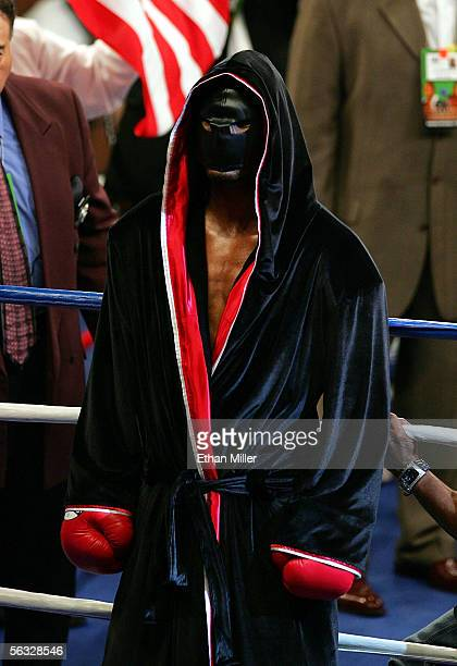 Bernard Hopkins enters the ring wearing an executioner mask before his fight with Jermain Taylor before the undisputed world middleweight...