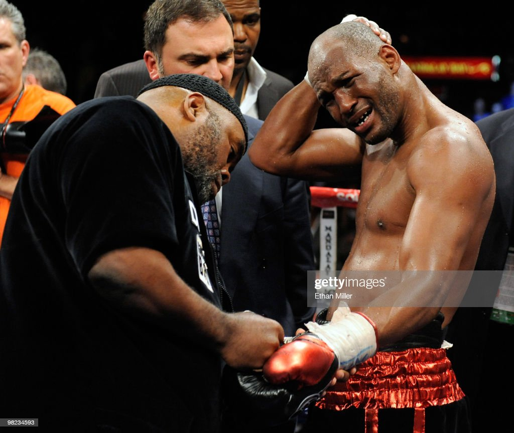 Bernard Hopkins (R) holds his head as his trainer Naazim Richardson takes his gloves off after Hopkins defeated Roy Jones Jr. in their light heavyweight bout by unanimous decision at the Mandalay Bay Events Center April 3, 2010 in Las Vegas, Nevada.