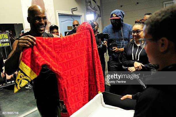 Bernard Hopkins is presented with a Versace robe from the Salabarria family at the conclusion of his media workout at the Joe Hand Boxing Gym on...