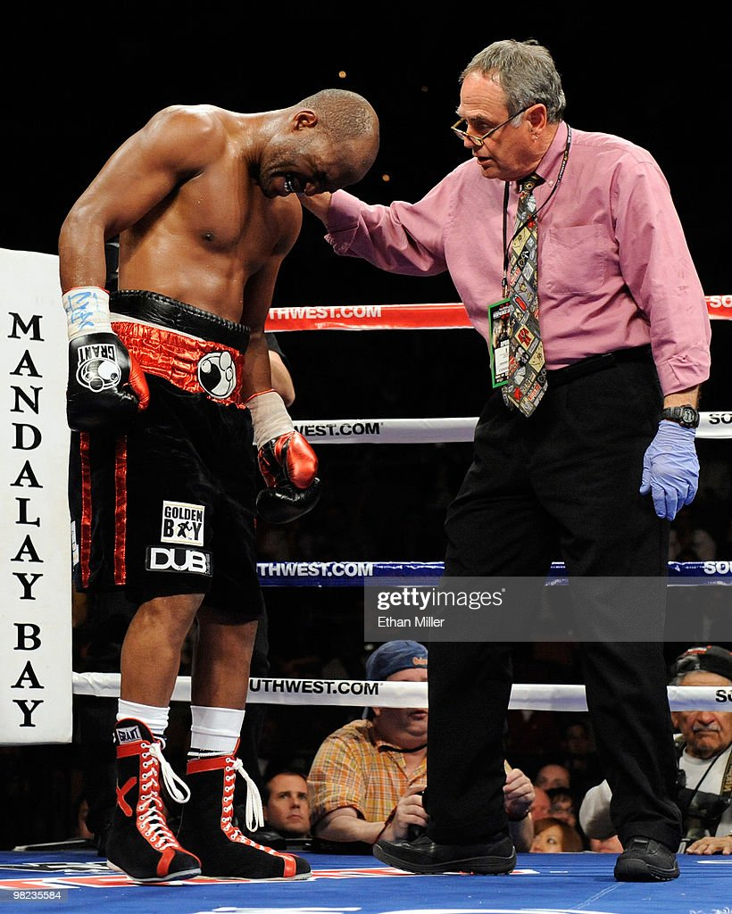 Bernard Hopkins (L) is tended to by ringside doctor William Berliner after Hopkins was hit in the back of the head by Roy Jones Jr. during the eighth round of their light heavyweight bout at the Mandalay Bay Events Center April 3, 2010 in Las Vegas, Nevada. Hopkins won by unanimous decision.
