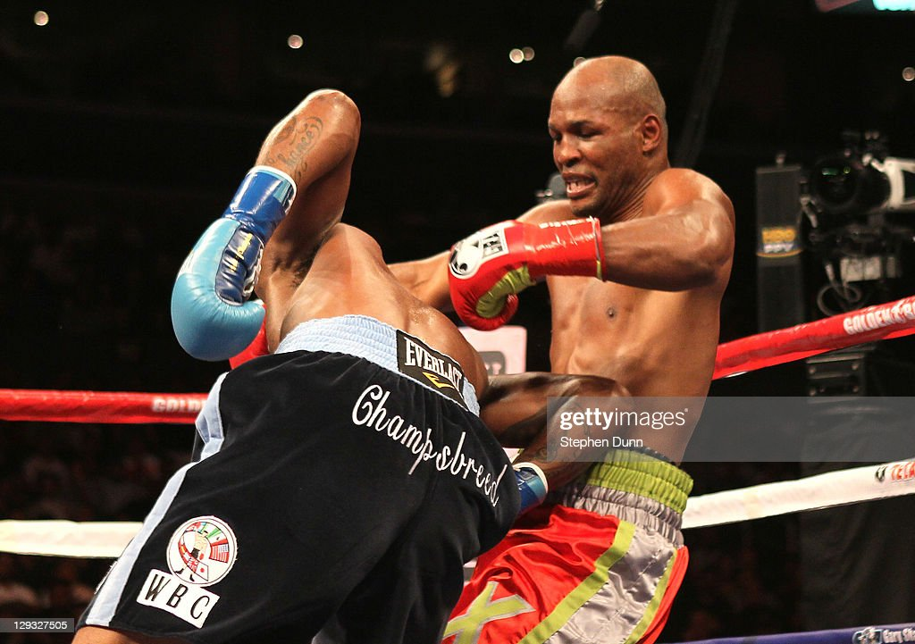 <a gi-track='captionPersonalityLinkClicked' href=/galleries/search?phrase=Bernard+Hopkins&family=editorial&specificpeople=171200 ng-click='$event.stopPropagation()'>Bernard Hopkins</a> (R) tangles with <a gi-track='captionPersonalityLinkClicked' href=/galleries/search?phrase=Chad+Dawson&family=editorial&specificpeople=4026852 ng-click='$event.stopPropagation()'>Chad Dawson</a> as he falls to the canvas in their WBC and Ring Magzine light heavyweight title fight at Staples Center on October 15, 2011 in Los Angeles, California. Hopkins injured his shoulder and was unable to continue and Dawson was awarded a TKO victory.