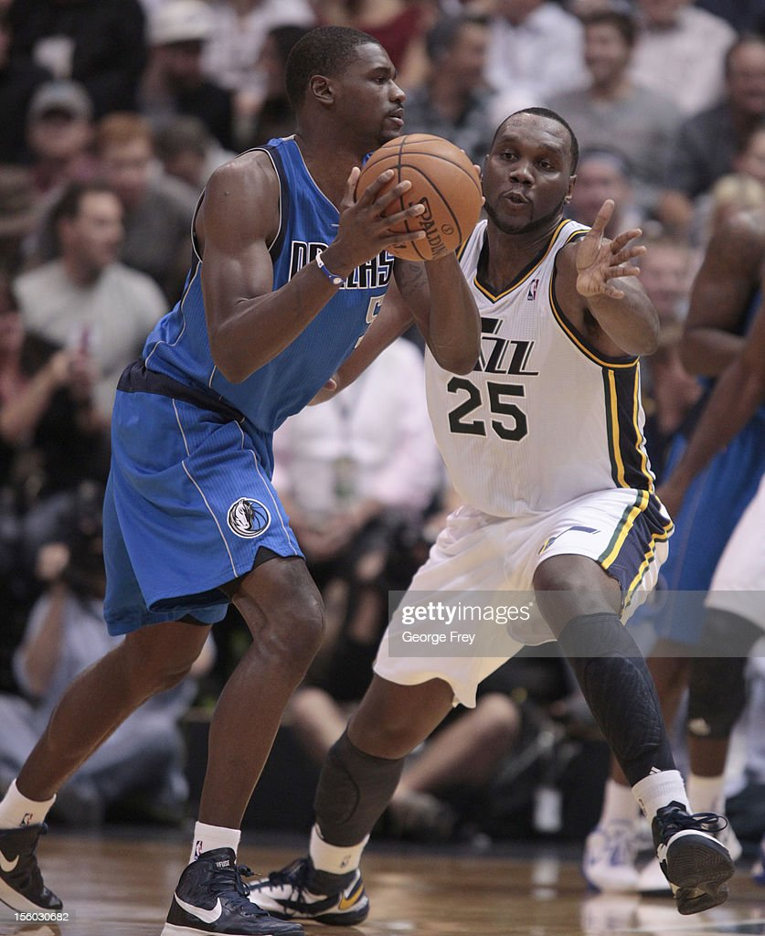 Bernard James #5 of Dallas Mavericks looks to pass the ball as Al Jefferson #25 of the Utah Jazz defends during the second half of an NBA game October 31, 2012 at Energy Solution Arena in Salt Lake City, Utah. The Jazz beat the Mavericks 113-94.