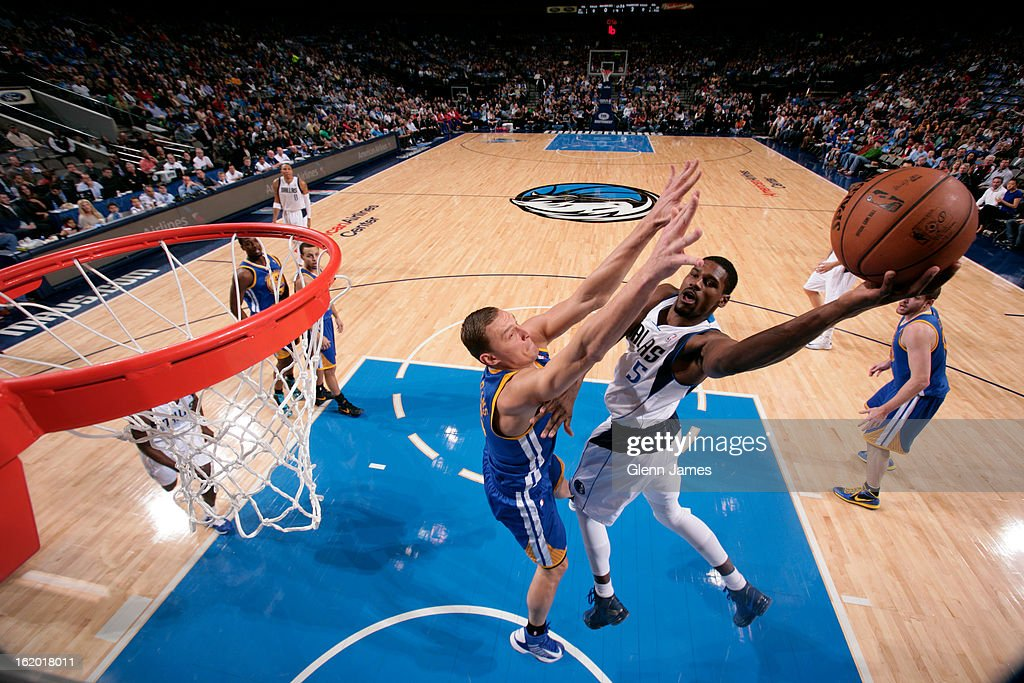 Bernard James #5 of the Dallas Mavericks drives to the basket against the Golden State Warriors on February 9, 2013 at the American Airlines Center in Dallas, Texas.