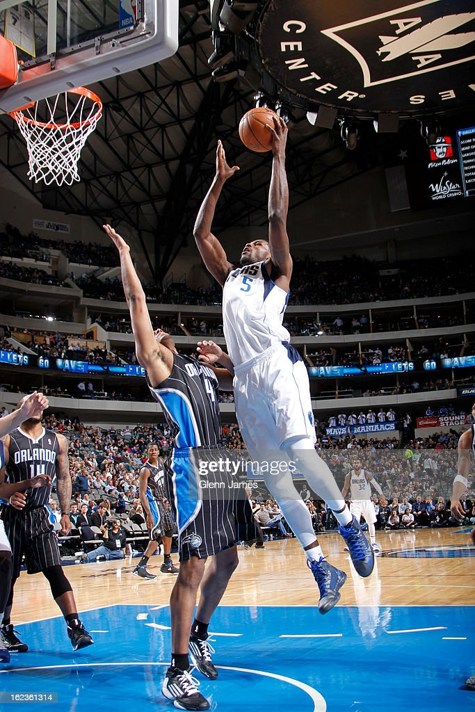Bernard James #5 of the Dallas Mavericks drives to the basket against the Orlando Magic on February 20, 2013 at the American Airlines Center in Dallas, Texas.