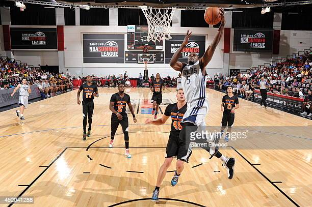 Bernard James of the Dallas Mavericks drives to the basket against the New York Knicks at the Samsung NBA Summer League 2014 on July 11 2014 at the...